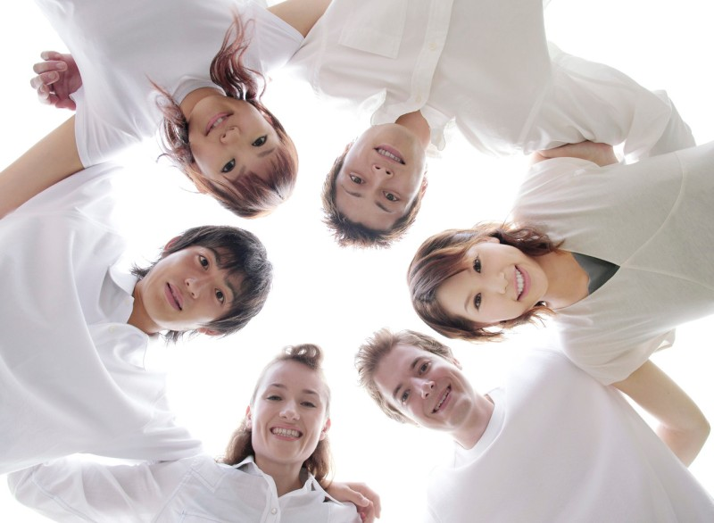 Group of Friends with Arms Around Each Other --- Image by © Royalty-Free/Corbis